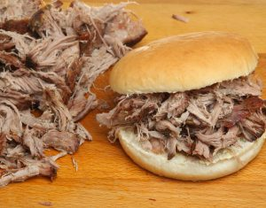 bigstock-Hog-roast-or-pulled-pork-roll--39038272